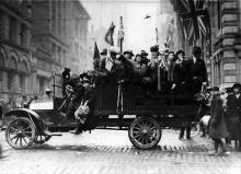 Happy Torontonians celebrate the Armistice at Terauley (Bay) and King Streets.
