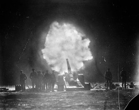 Canadian artillery firing at night.