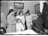 The Fraser family from Toronto learns of the Armistice. From left to right, Mrs. J. Fraser, Jos. Fraser Jr., Miss Ethel James, Frank James, Norman James.
