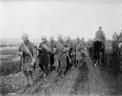 Weary Canadians marching at the Somme (1916).