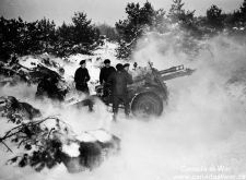 "Near Malden, Holland ""B"" Troop 5th Field Regiment members fire a 25-pounder on February 1, 1945."