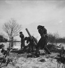 Canadians of the Kensington regiment, British 49th Division, firing trench mortars near Zetten, Netherlands on January 20, 1945.