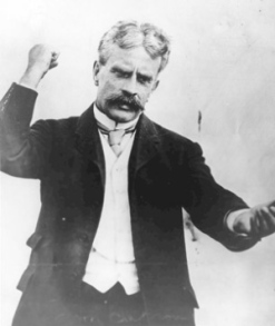 "Robert Borden was Prime Minister from 1911 to 1920 and oversaw a coalition ""Unionist"" government during WW1. Laurier vs Borden in the 1917 election was highly contentious. Conscription was the main issue of the election---Borden was in favor and won. (Note: Sources claim this is a photo of him campaigning, but the photo is undated so that may not be true)."