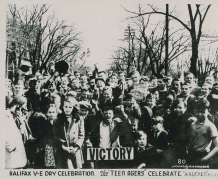 Teenagers in Halifax come together to celebrate VE-Day. Unfortunately, festivities in Halifax were marred by riots---an event that sadly occurred in a number of cities across Allied countries.