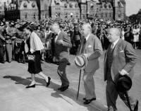 A formal ceremony was held at Parliament to mark the end of the war. (L-R): Mrs. Vivot, H.E. Dr. Eduard Vivot (Minister to Canada from the Argentine Republic), Prime Minister William Lyon Mackenzie King, H.E. Dr. Frantisek Pavlasik (Minister to Canada from the Czechoslovakian Republic).