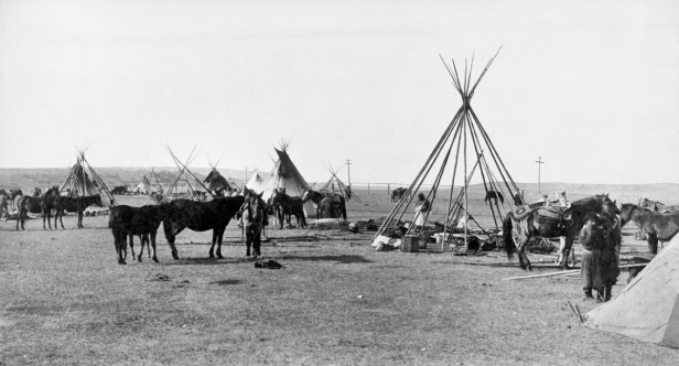 Sarcee (Tsuu T'ina) people moving camp on outskirts of Calgary, Alberta. (A. Ross, 1886)