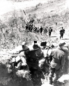Soldiers from the Royal Canadian Regiment head into a valley, 1952. (Paul E. Tomelin, LAC - PA129742)