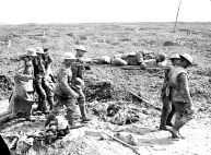 Stretcher bearers and German prisoners bringing in wounded during the Battle of Vimy Ridge