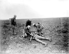 Tending a wounded German on the battlefield. Vimy Ridge.