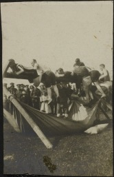 Soldiers participate in a greasy pole pillow fight?!